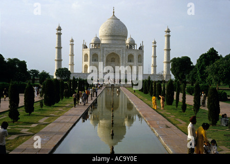 Tourists visiting the Taj Mahal, Agra, India in the early evening - Stock Photo