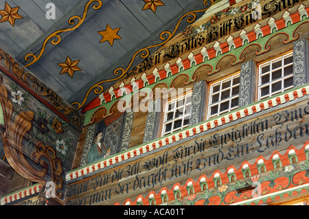 Painted traditional Swiss chalet, painting of house builder, Daerstetten, Simmental, Switzerland - Stock Photo