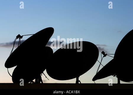 Satellite dishes on a roof - Stock Photo