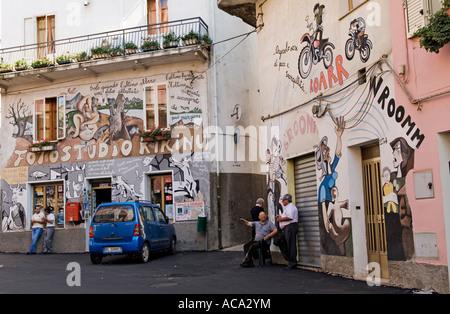 Village square with famous murals, Orgosolo , province Nuoro, Sardinia, Italy - Stock Photo