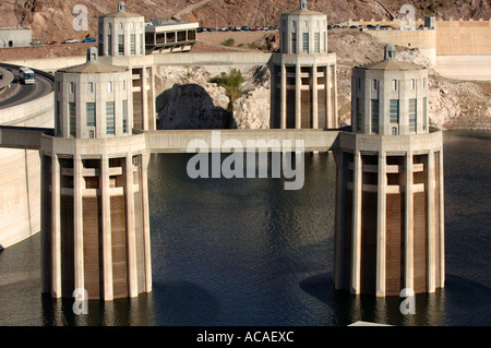 Hoover Dam water inlet towers Colorado River border between Nevada and Arizona states USA - Stock Photo