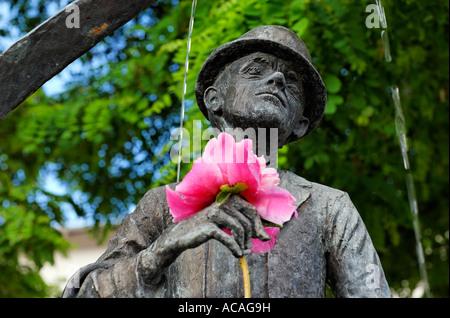 Karl Valentin monument (fountain) with flower at the Viktualienmarkt, Munich, Bavaria, Germany - Stock Photo