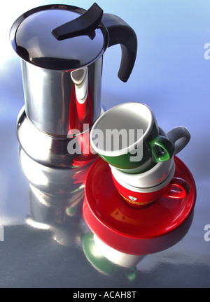 Coffee percolator with three cups in the colours of the italian flag - Stock Photo