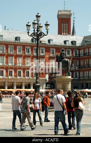 Madrid Spain Europe EU. Plaza Mayor the 17th century porticoed square. Statue of Felipe III. tourists - Stock Photo