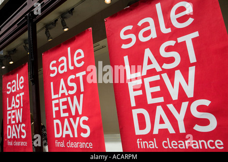 Sale last few days signs hanging in shop window - Stock Photo