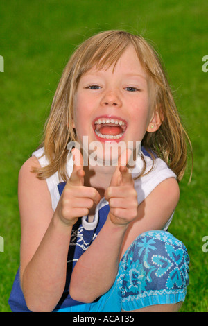 Portrait of young six year old girl - Stock Photo
