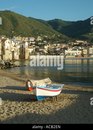 small boats pulled up on the beach at Cefalu, on the North coast of Sicily - Stock Photo