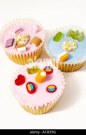 Fairy cakes decorated with sweets - Stock Photo
