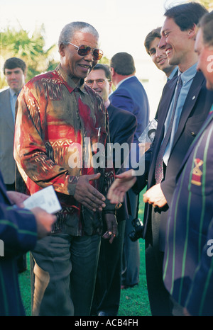South Africa President Nelson Mandela meets 1995 World Cup Rugby players in Parliamentary Gardens Cape Town South - Stock Photo
