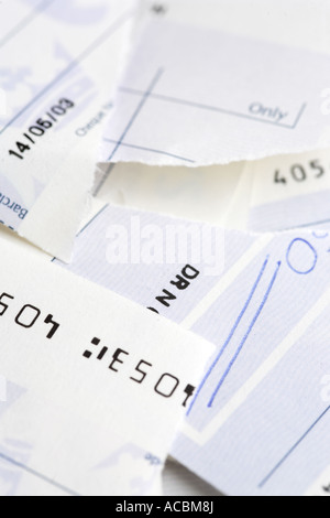 Close up of Bank cheque check torn up - Stock Photo