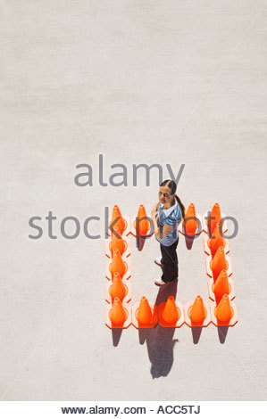 Woman inside box of traffic cones - Stock Photo