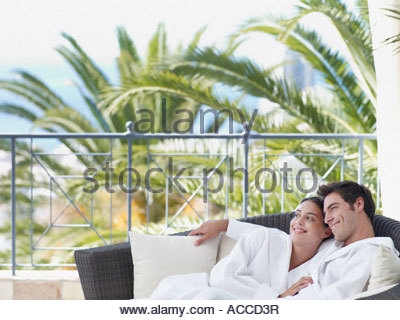 A couple relaxing in bathrobes - Stock Photo