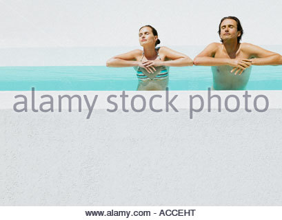 Man and woman in pool - Stock Photo