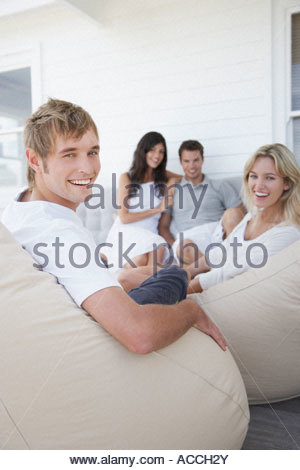 Two couples sitting on a terrace - Stock Photo