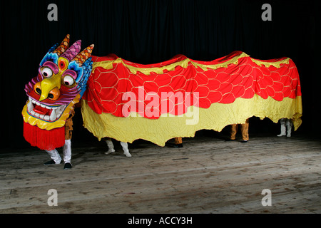 Asia celebration celebrations China Chinese New Year dance dancers dancing dragon entertainment face faces festival - Stock Photo