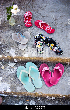 Brightly-coloured flip-flops. - Stock Photo