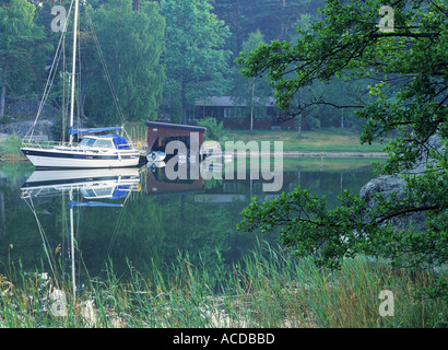 Country homes on inland waterways with sailboats and boat houses in Stockholm Archipelago and along East Coast of - Stock Photo