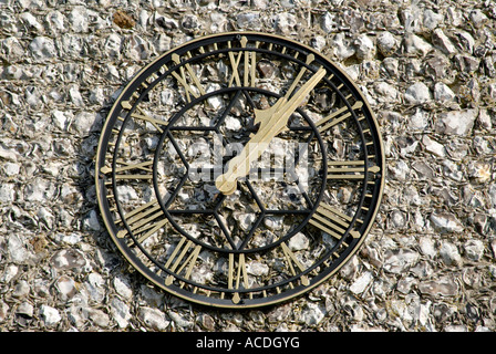 Church clock on tower. St Laurence Church South Falmer Brighton East Sussex UK United Kingdom - Stock Photo