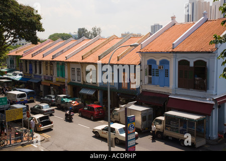 Traditional colourful shophouses Buffalo Road with traffic in ethnic neighbourhood from above Little India Singapore - Stock Photo