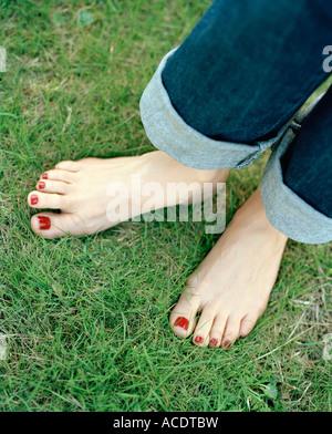 Red nail polish on toenails. - Stock Photo