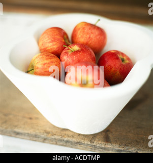 Apples in a bowl on a table close-up. - Stock Photo