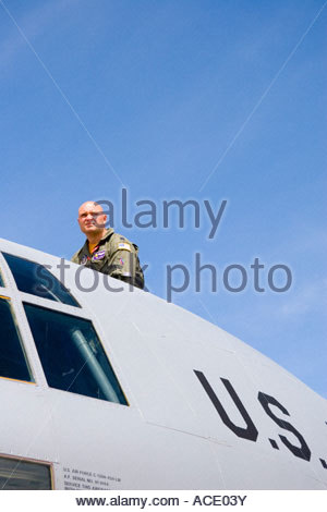 U.S. airman looking out from the cockpit of a C130H Hercules cargo aircraft carrier. RAF Fairford, UK. - Stock Photo