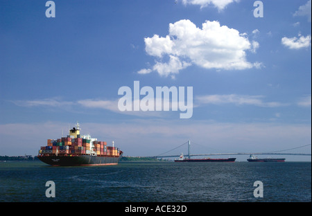 A large ocean going container ship sailing in New York harbor, New York, USA - Stock Photo