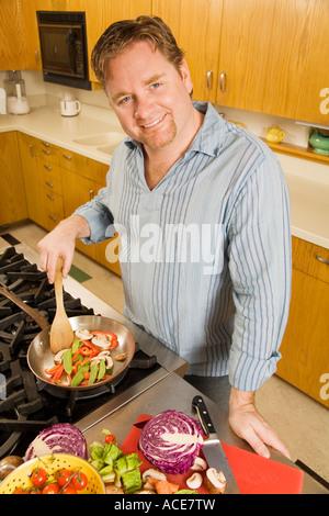 Man cooking - Stock Photo