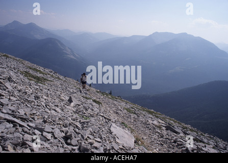 A hiker on the Half Dome Crag Trail in the Badger-Two Medicine roadless area of the Northern Rocky Mountains, Montana, - Stock Photo