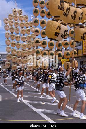 Lantern poles weighing up to 60 kilograms are balanced during the Kanto Matsuri festival in Akita - Stock Photo