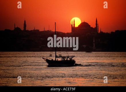 Istanbul Turkey Sunset over Aya Sofya Hagia Sophia with sailboat on the Bosporus  - Stock Photo