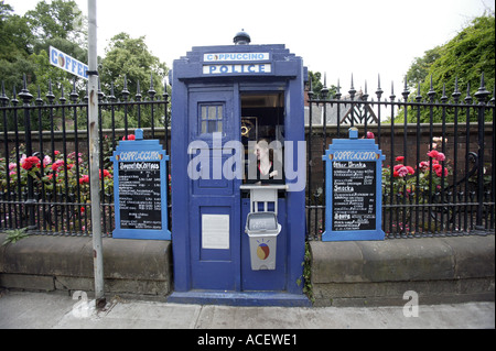 A blue concrete police box converted int a coffee bar on the Great Western Road in Glasgow Scotland - Stock Photo