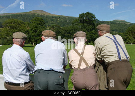 Shepherds watch the Welsh Sheepdog Trials on the Glanusk Estate Crickhowell Powys Wales UK - Stock Photo