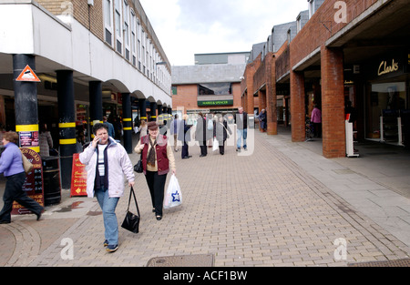 Carmarthen town centre Carmarthenshire Wales UK GB EU people in modern pedestrianized shopping street - Stock Photo