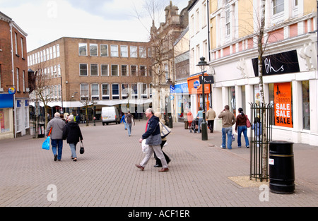 Carmarthen town centre Carmarthenshire West Wales UK people shopping in modern and traditional pedestrianised street - Stock Photo