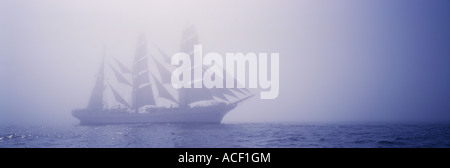 Panorama Ship white sails in fog - Stock Photo