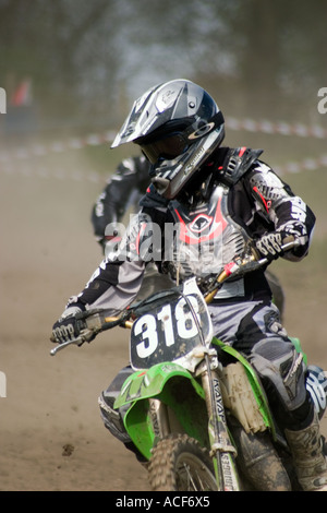Motocross riders cornering during race - Stock Photo