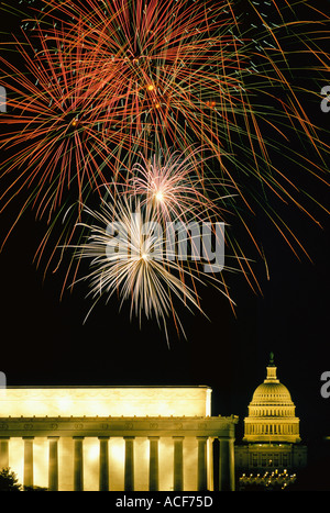 Fourth of July fireworks burst over the Lincoln Memorial and Capitol Washington DC - Stock Photo
