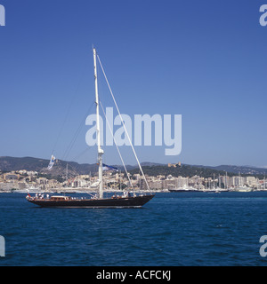 Superyacht Cup Palma 2007 - Super Sailing Yacht motoring out past Bellver Castle, Palma de Mallorca. - Stock Photo