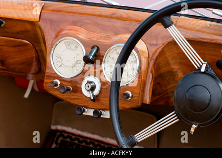 Wooden dashboard in a old car - Stock Photo