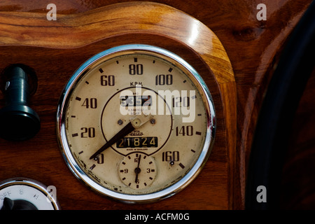 Speedometer in a wooden dashboard - Stock Photo