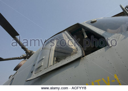 Croatian Air Force Mi-8 helicopter exterior of cockpit details, very low against clear blue sky view - Stock Photo
