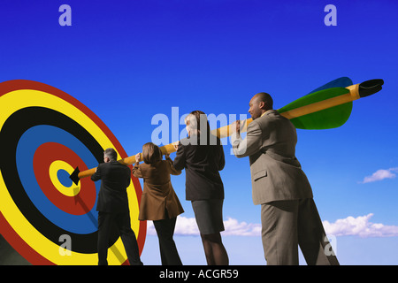 Business people putting arrow on target - Stock Photo