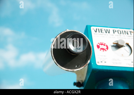 A telescope at the coast from a high viewpoint - Stock Photo