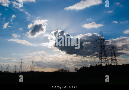 National Grid Electricity Pylons carrying power from Sizewell A and B nuclear power stations off the Suffolk coast, - Stock Photo