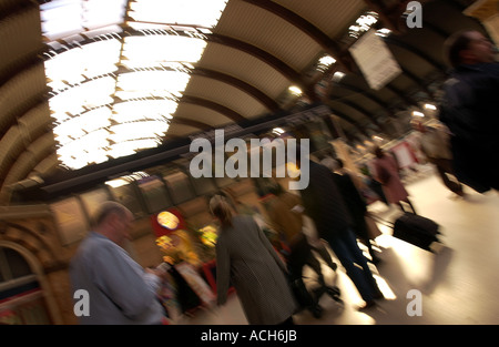 Commuters at York Railway Station, UK - Stock Photo