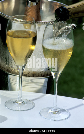 Champagne being poured into glasses Relais et Chateau Michelin three stars Les Crayeres Reims Marne Champagne France - Stock Photo