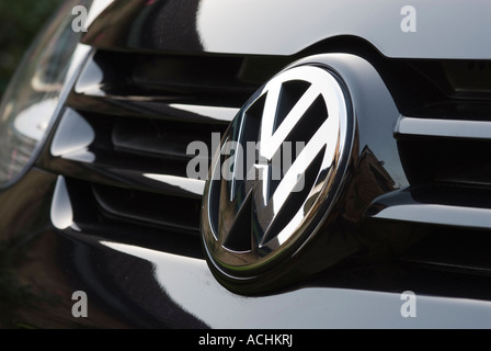 Volkswagen badge on the front of a VW Golf car - Stock Photo