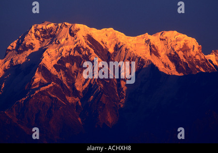 Nepal Sarangkot Morning sun lights snow covered peaks in the Annapurna Massif in the Himalayan Mountains - Stock Photo