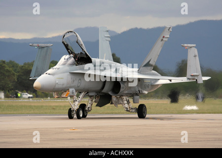 Military aircraft. F-18 Hornet fighter jet airplane of the Royal Australian Air Force taxiing with open cockpit - Stock Photo